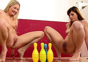 Cayla and Loreen toy each others pussies with skittles