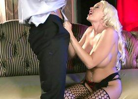 Bimbo in sexy stockings fucks a load out of the stud