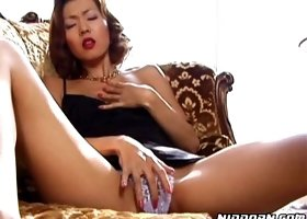 Voluptuous Asian babe examines her juicy slit in solo
