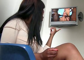 Ebony Angelica Wilson watches porn in a gloryhole room