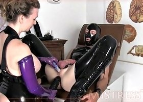 leather wearing slave gets toyed by deviant mistress