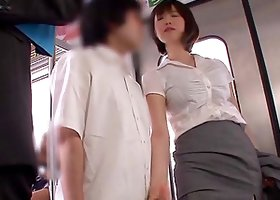An Asian office girl strokes a dick in a subway train