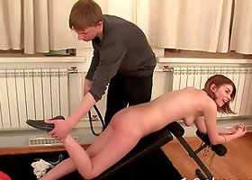 She wears a collar and leash as her master uses her pussy