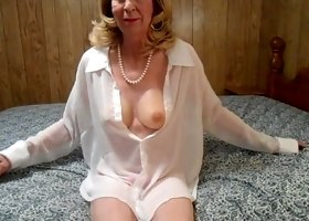 Perverted crossdresser with fake tits was teasing himself on the wide motel bed