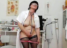 Mature Nurse With Glasses Shows How Horny She Is Using Dildo