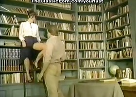 Raven haired shy chick in glasses Bridgette Monet fucks with her stud in the library