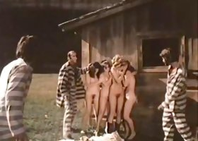 Kinky prisoners fuck three nude girls in a village shed