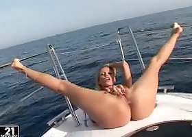 Cute blonde Sandy enjoys fingering her pussy on a yacht